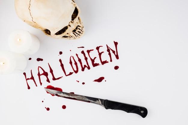 Palabra sangrienta de halloween y cuchillo