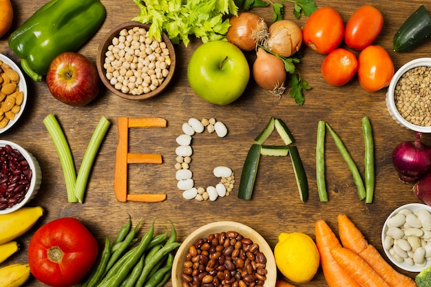 Palabra vegana plana con letras vegetales