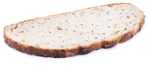 Pan multigrano blanco y semillas en rodajas.