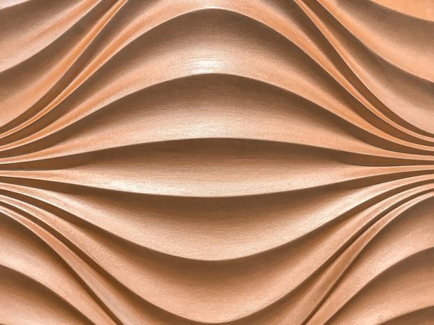 Panel decorativo de pared interior en oro rosa 3d con patrón ondulado.
