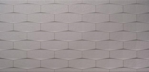 Panorama del fondo de pared de azulejos de piedra blanca moderna