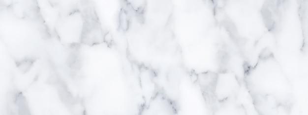 Panorama de textura de piedra de mármol blanco para el fondo o piso de baldosas de lujo y diseño decorativo de papel tapiz.