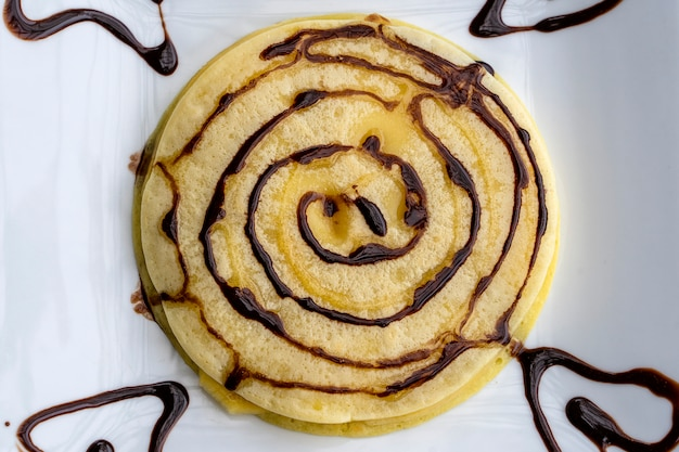 Panqueques con sirope de chocolate