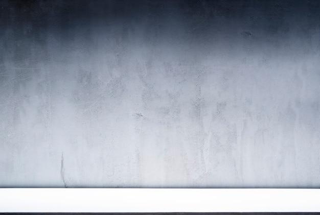 Pantalla de fondo de espacio en blanco para diseño de presentación de luz iluminada degradada decorada sobre fondo de textura de muro de hormigón
