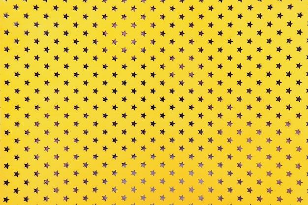 Papel de aluminio con patrón de estrellas plateadas.