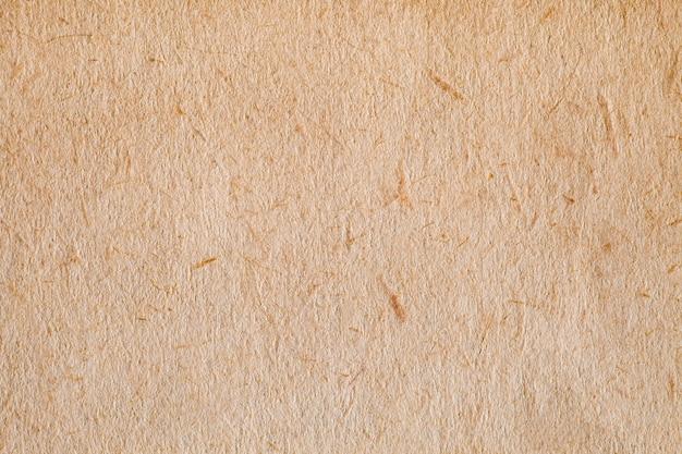 El papel es de color naranja antiguo áspero, estructura de fondo, vista macro de primer plano