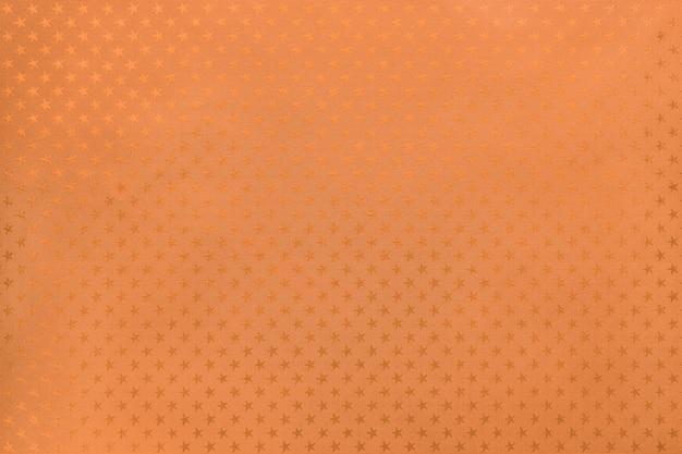 Papel de lámina de metal naranja con un patrón de estrellas