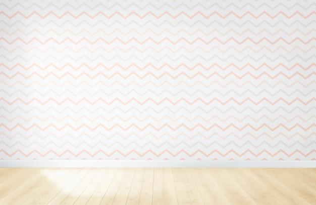 Papel pintado en colores pastel en una habitación vacía con piso de madera
