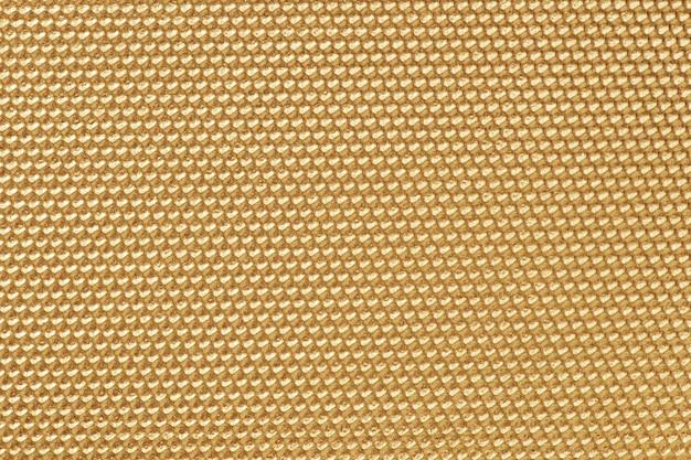 Papel pintado con patrón de panal de color dorado