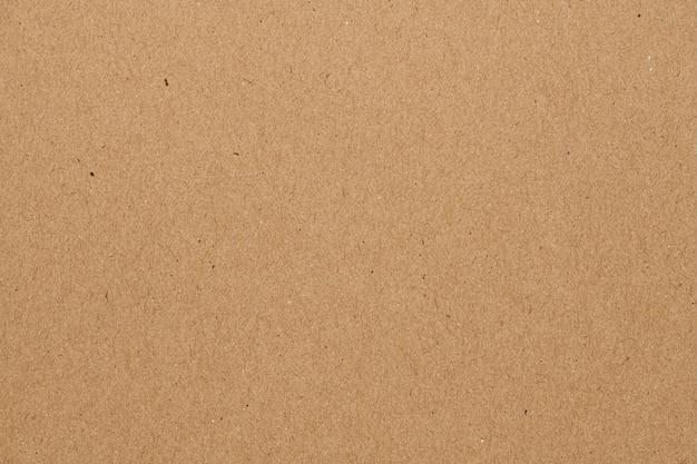 Papel pintado con textura de papel marrón en blanco