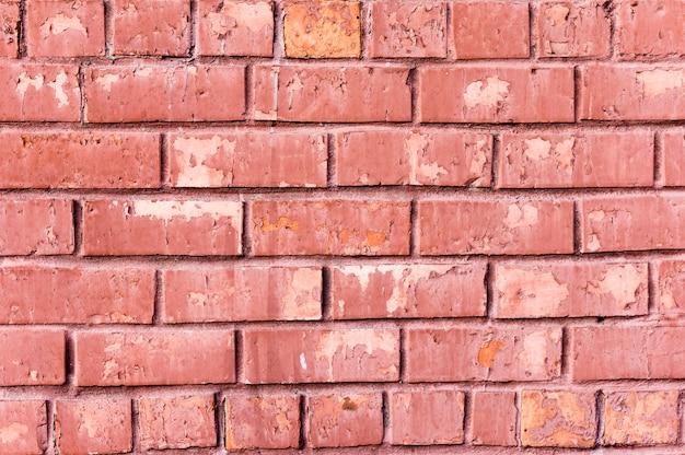 Papel pintado viejo de la pared de ladrillo