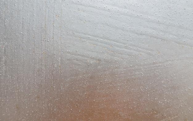 Papel de plata del metal de la textura de la hoja del fondo. brillante pared de oro blanco brillante.