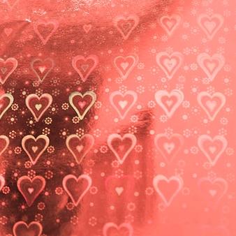 Papel rosa dulce con patrón de corazones