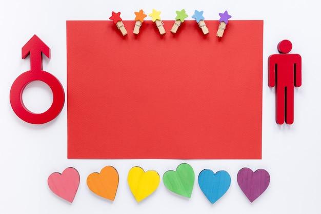 Papel con símbolo de género y corazones