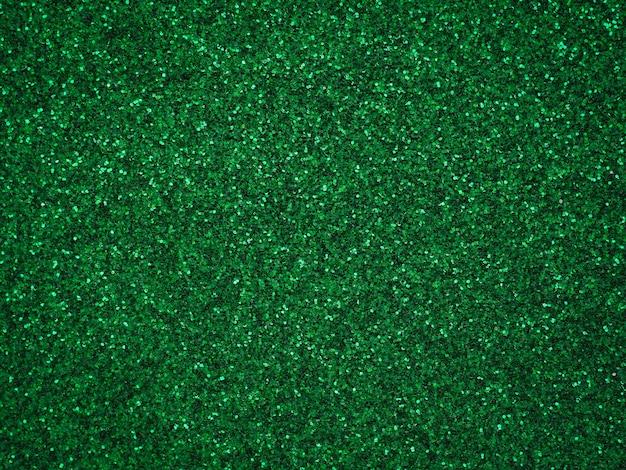 Un papel verde reluciente. textura abstracta de plata brillo luz bokeh