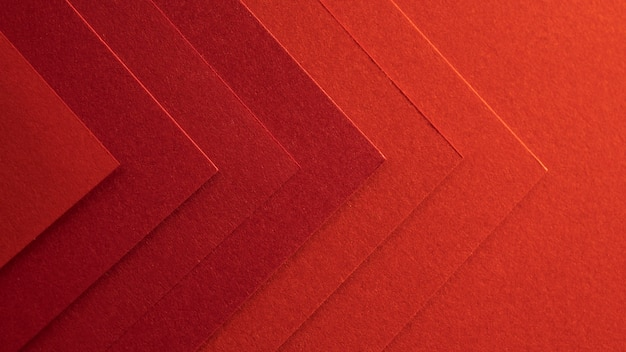 Papeles rojos elegantes en forma de flecha