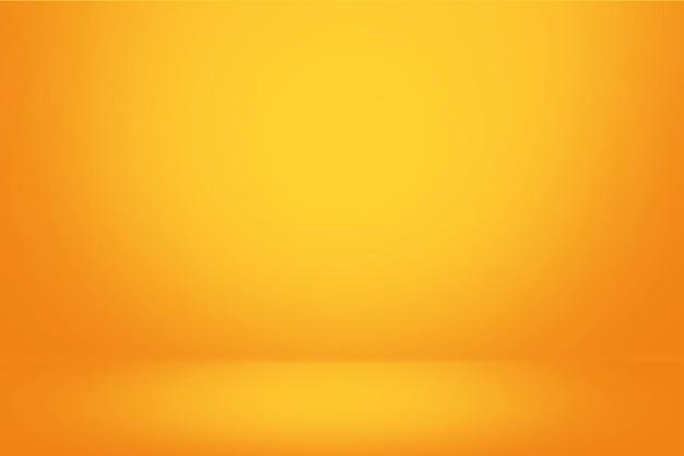 Pared amarilla del gradiente y fondo vacío de la habitación del estudio