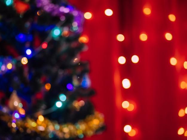 Pared del árbol de navidad. bokeh de año nuevo