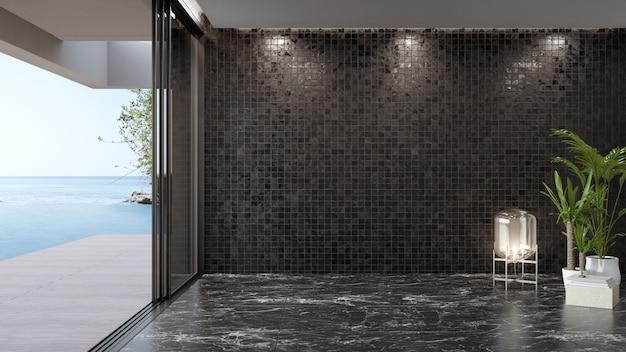 Pared de azulejos oscuros en blanco sobre piso de mármol negro vacío de gran salón con plantas