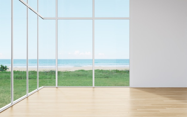 Pared en blanco en el piso de madera vacío del gran salón en casa moderna con vista a la playa y al mar