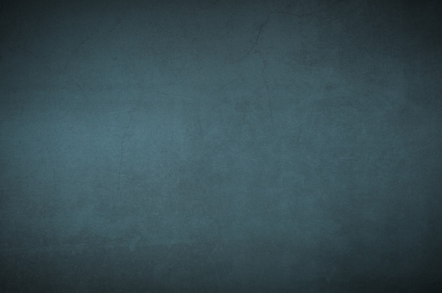 Pared del fondo del azul viejo texturizado envejecido del yeso.