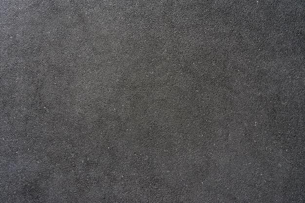 Pared de grava pequeña mezcle con piedra gris blanca y negra para hacer una pared o piso en el edificio.