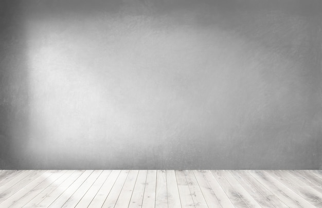 Pared gris en una habitación vacía con piso de madera.