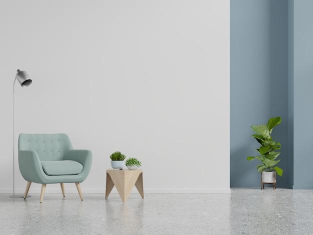 Pared interior de la sala de estar con sillón azul sobre fondo de pared blanca vacía.