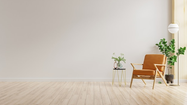 Pared interior de la sala de estar en tonos cálidos con sillón de cuero en la pared blanca. representación 3d
