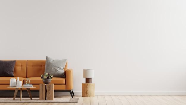 Pared interior de la sala de estar en tonos cálidos con sofá de cuero en la pared blanca. representación 3d