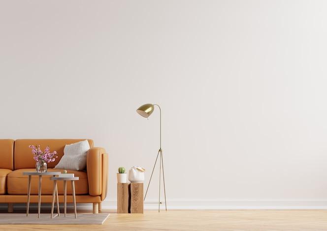 Pared interior de la sala de estar en tonos cálidos con sofá de cuero sobre fondo de pared blanca. representación 3d