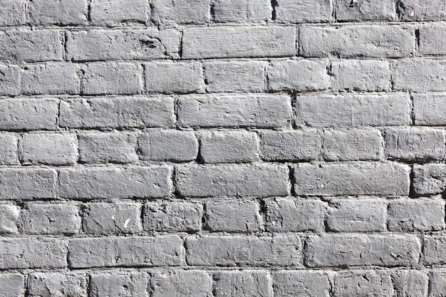 Pared de ladrillo antiguo pintado de ladrillo blanco, detalles de construcción