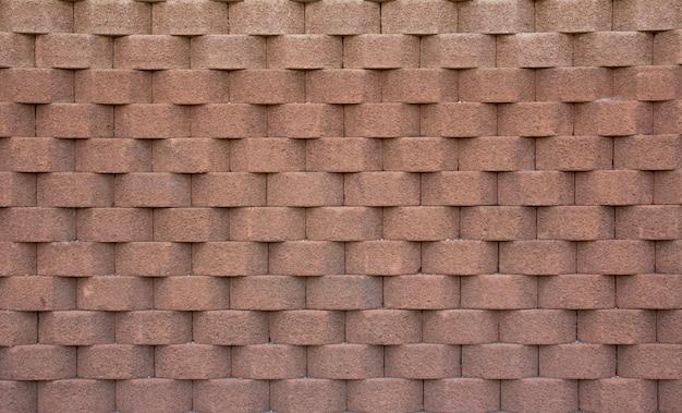 Pared de ladrillo con formas geométricas de color marrón claro. sensación de profundidad. textura. fondo.