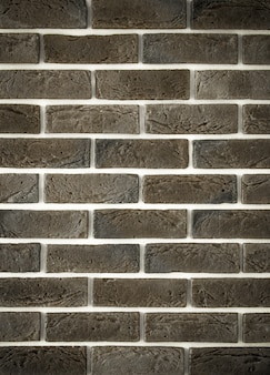 Pared de ladrillo gris claro, primer plano creativo de back-phonon