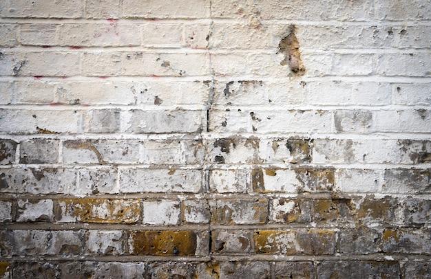 Pared de ladrillo sucio sucio rojo blanco y gris textura de fondo
