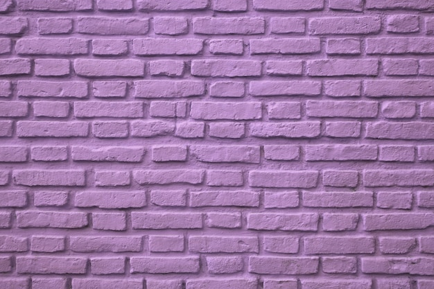 Pared de ladrillo viejo color púrpura para el fondo