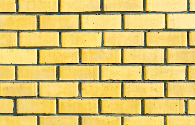 Pared de ladrillos de luz amarilla. textura de ladrillo, hermoso fondo
