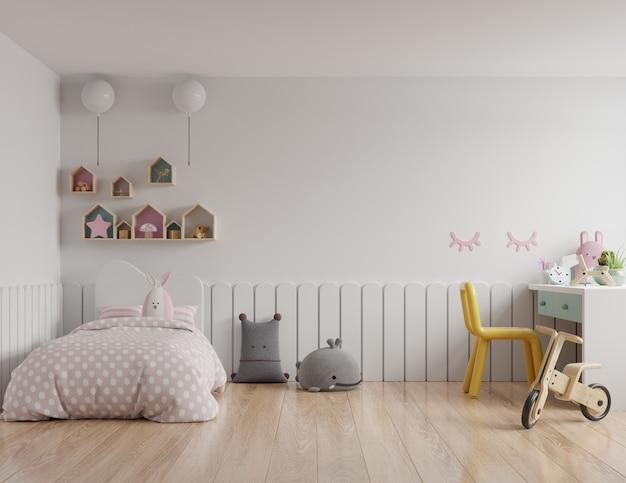 Pared de maqueta de dormitorio en la habitación de los niños en pared blanca