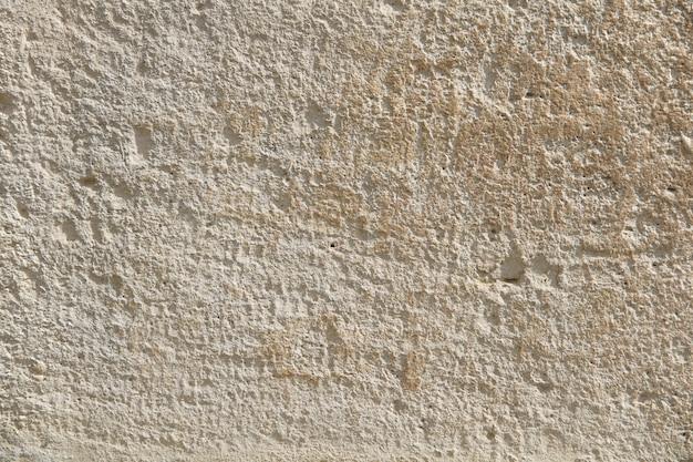 Pared de piedra con intersticios en toda la superficie