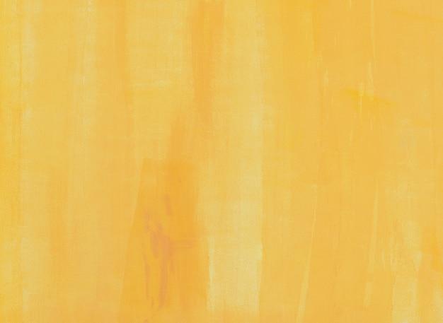 Pared de pintura naranja con patrón de pincel.