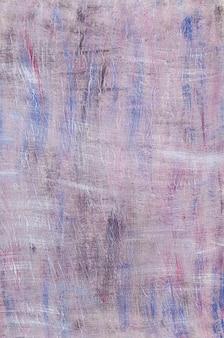 Pared con textura pintada con manchas de varios colores.