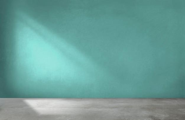 Pared verde en una habitación vacía con piso de concreto