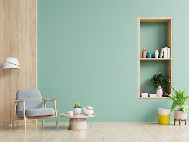 Pared verde interior con sofá gris y decoración en sala de estar