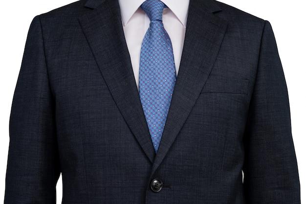 La parte superior del cuerpo de un hombre de negocios en un traje blanco