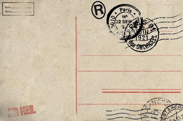 Parte trasera de la postal de correo aéreo en blanco con manchas sucias