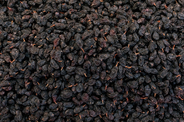 Pasas negras dulces superficie seca de uvas dulces