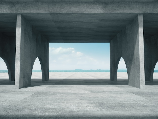 Pasillo de hormigón con el espacio del mar.