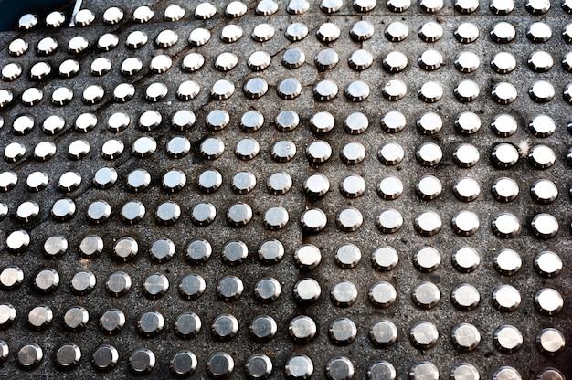 Patrón de bloque metálico braille.