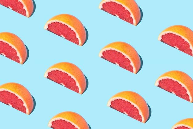 Patrón de comida de moda alimentaria con pomelos.