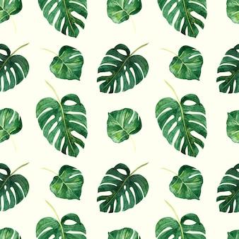 Un patrón sin costuras con hojas tropicales